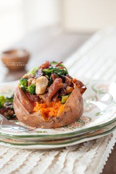 "Stuffed Sweet Potatoes. ""When I'm looking for something simple and hearty to eat, I love to make Paleo Stuffed Sweet Potatoes. You can stuff it with whatever you'd like, but my favorite is this recipe that contains chicken, bacon, and broccoli, Brussels sprouts, and spinach. It is a great way to use up leftover veggies and gives you an entire meal in one tasty package. Feel free to sub in whatever vegetables you have in your fridge!"""