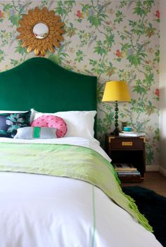 An eclectic look, a little Madcap Cottage, a little eccentric English country. #bedroomdecor Green velvet bed from Sofas and Stuff in front of a floral wallpaper by Little Greene called Paradise in colourway Feather. The bedside lampshades are velvet and are from Pooky.com and the Mirror is a find on Exclusivemirrors.com #interiorstyling #interiors4all #bedroomdecor #littlegreene #greenvelvetbed#velvetbed