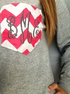 gray sweatshirt with a monogrammed pocket.