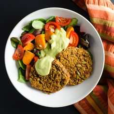 Spicy Lentil Quinoa Burgers with avocado dressing - these gluten-free vegan veggie patties offer a flavorful blend of protein-rich plant-based ingredients with a little kick. | VeggiePrimer.com