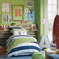 "Joshua's green room #6 Yes: loves the green in this scheme, orange and navy, loves the initial letters (painted initial and marquee), and very text-oriented wall elements.  But ""I hate, hate, hate that door color (bright white)."""