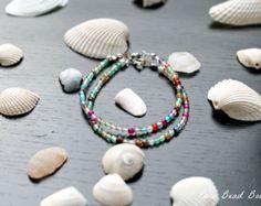 Iridescent Single-Bead Bracelet by PureBeadBoutique on Etsy
