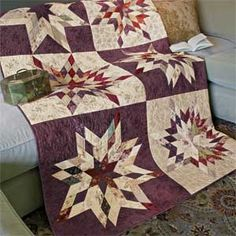 """Lone Star Sampler: 2 1/2"""" Precut Jelly Roll™ Strip-Pieced Quilt Pattern Designed by LISSA ALEXANDER Machine Quilted by ANGELA McCORKLE of QUILTS WITH A HEART, patterned in the McCall's Quilting January/February 2014."""