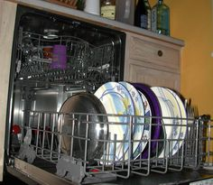 As part of my apartment therapy:  wikiHow to Clean and Maintain a Dishwasher -- via wikiHow.com