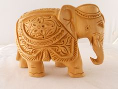"Hand carved elephant.  Assorted sizes ranging from 2"" height to 7.5"" height."