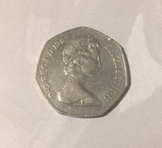 Fifty pence coin dated 1982 from United Kingdom. In good circulated condition with natural patina.