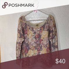 Free People Floral Sweater! Sz S Free People Floral Sweater! •Neutral florals match with almost anything! • Goes great with your favorite jeans or skirt/shorts •GUC •Tag looks slightly green from the metal Free People Sweaters Crew & Scoop Necks