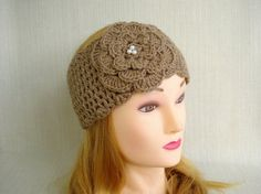 Warm and stylish winter headband ear warmer  with a beautiful crochet flower . Wear for fashion or to cover those ears in cool weather.    This