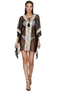 Your getaway bag isn't complete until you have this Vero Milano sheer rhinestones poncho. Styled with low-dipping neckline, gold details and side tassels, the Vero Milano sheer rhinestones poncho is a must have for a stroll along the beach or poolside. Coachella, Rhinestones, Must Haves, Tassels, Cover Up, Neckline, Spring Summer, Bag, Swimwear