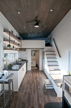 """Today we have a treat for you—another beautiful tiny house designed by Minimaliste in Canada. This home is called """"Lilas,"""" and was commissioned by a young couple in Quebec. Small Tiny House, Modern Tiny House, Tiny House Cabin, Tiny House Living, Tiny House Design, Tiny House Stairs, House Plan With Loft, Loft House, Tiny House Plans"""