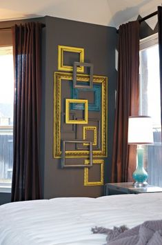 cool way to fill a weird wall -- I might do this and paint the frames the same colors as my two accent walls to tie everything together!