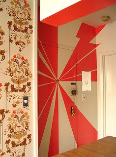 I love the wallpaper next to this 70's type mural. Want to do this in my apartment.