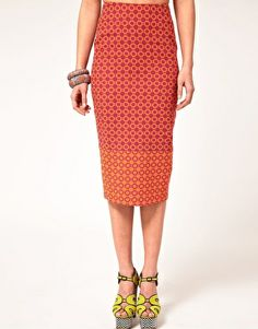 ASOS Pencil Skirt In Jacquard  $62.67NOW $50.13  Jacquard pencil skirt by ASOS Collection. Crafted in a cotton blend fabric with a woven jacquard design. Featuring a fitted high waist, a color block hem, and a concealed zip fastening with vent detail to the reverse hem. Designed with a tailored fit and midi cut length.