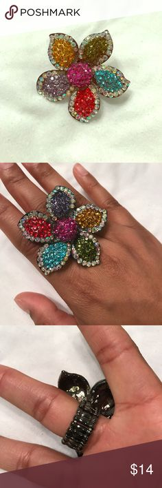 Multicolored dazzled flower ring Fits size 7-8. Stretchy ring in great condition NWOT Jewelry Rings