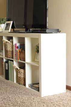DIY entertainment center---put a 4x3 horizontally under the TV then put two 2x4's (one on each side) to put DVD's in.