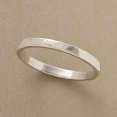 HAMMERED POLISHED STERLING BAND--A handhammered band of antiqued sterling silver to wrap around your finger with simple grace. Whole sizes 5 to 9.
