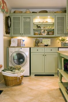 laundry room- love the green cabinets    I like this... wish I could make my kitchen look like this...