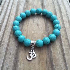 A personal favorite from my Etsy shop https://www.etsy.com/listing/258541066/natural-stone-turquoise-bracelet-with-om