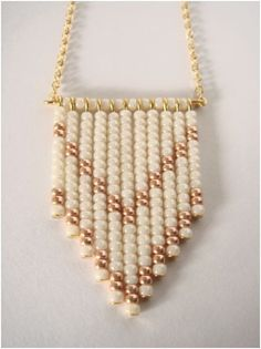 Beaded white and gold chevron long necklace. $22.00, via Etsy.
