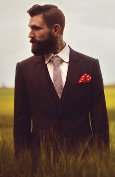 I love a man with a beard an isn't scars to wear a suit an tie at the same time.