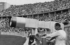 A German technician checks the Television canon put in the Olympic Stadium, Aug. 1, 1936. The huge electronic camera build by Telefunken broadcast live for the first time, 8 hours each day, the Berlin Olympics Games show.