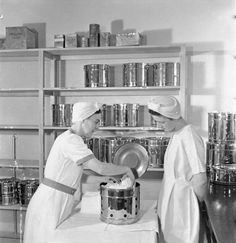 Sister McEwen, Sister-in-Charge-of-the-Theatre (left), shows student nurse Joyce Collier how a drum of bandages should be packed for the steriliser at St Helier Hospital, Carshalton. Student Nurse, Nursing Students, Medical History, Local History, Sutton Surrey, Saint Helier, Old Hospital, Vintage Nurse, School Pictures
