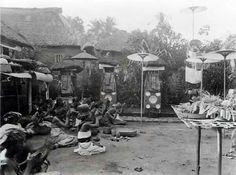 Balinese praying in a family courtyard, Bali, c. 1920.