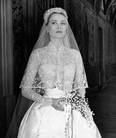 Grace Kelly photographed in her bridal dress just before the wedding ceremony where she will marry Ranier III of Monaco