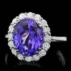 Gemone Diamond presents 7.40 Ct Natural Tanzanite engagement rings with 14k white gold and SI clarity at wholesale price. Free shipping.