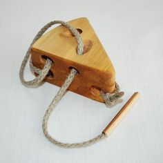 Wooden cheese lacing toy made by linenkids on etsy. We have one of their lacing toys and they are very nice.