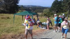 HILLTOP WATER STOP - This water station at the top of the steepest and longest hill on the Fruitloop course was a popular place. You can see some of the other Fruitloopers still on their way up the windy road.  More Matakana summer fun.. http://www.matakanacountry.co.nz/markets-lodging-accommodations-auckland-coast-wine-country-hotels/the-best-of-matakana-things-to-do-in-matakana-nz-auckland-wine-region-area-attractions/ #matakana #auckland #newzealand #thingstodo