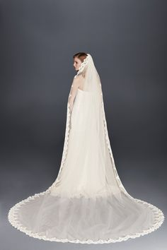 Tiny sequins glint from the scalloped edges of this lengthy tulle veil. | Corded Lace Cathedral Veil with Scalloped Edge from David's Bridal