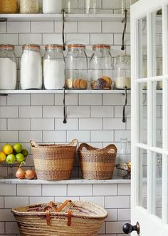 Design Chic: Kitchen Organization Subway tile back splash, brackets holding marble shelves, glass and baskets