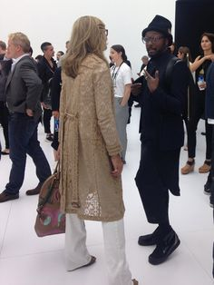 Pin for Later: We Take You Behind the Scenes of Apple's iPhone Launch Will.I.Am. was also present. Because, why not? The Black Eyed Peas band member chatted up ex-Burberry CEO Angela Ahrendts, Apple's first female executive. Photo: Nicole Nguyen