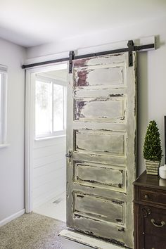 Here's how to repurpose an old barn door into a sliding version. #CrystalCreekBuilders