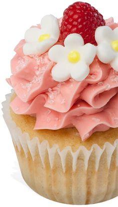 Raspberry Peach Blossom -- Moist peach cake with raspberry filling, topped with raspberry buttercream.   Gigi's Cupcakes