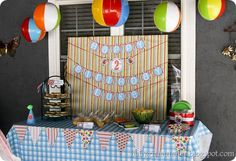 I Love the beach balls used as decorations!! No need for balloons. I'm just wondering how to make them stay.