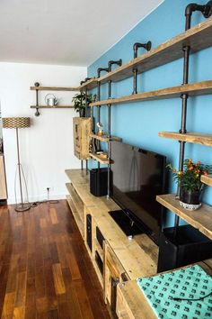Aurelie Industrial Reclaimed Scaffolding Board And Dark Steel Pipe Multi Media And Shelving Unit Bespoke Systems Urban Apartment, Parisian Apartment, Industrial Apartment, Industrial Pipe Shelves, Scaffold Boards, Muebles Living, Shelving Systems, Pipe Furniture, Furniture Outlet