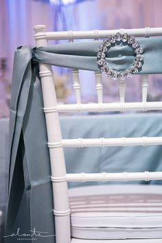White chiavari chair with blue and rhinestone chair cover