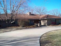 Call Arlan at 316-284-1973 or email me at Arlan@ArlanNewellcom to set you private showing  Wow Unbelievable property with country amenities but located WITHIN the city limits. Approx. 3.6 acres w beautiful stone lined pond and dock area. Overlooking the pond is an awesome 35 X 37 covered patio area separate entertainment deck and in-ground salt water pool with extra laying out area. The amazing covered patio has stained concrete a kitchenette area and exterior bathroom w shower. It is a…