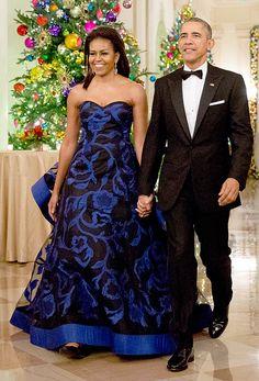 Michelle Obama in a blue strapless Oscar de la Renta dress
