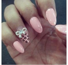 Leopard nail art with 3d crystal bow with diamond from Holly Nails in Temple City Ca