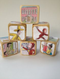 Etsy listing at http://www.etsy.com/listing/129392987/curious-george-childrens-book-blocks