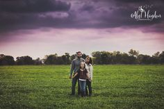 family poses, poses, family of three, field, grass, sky, colors, fall, outside shoot, couple, love, kiss, family, photo, photography, outside, country, fall, fam, barn shoot