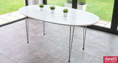 The modern Ellie White Oval Dining Table is a minimalist's dream table. The fashionable table top is white satin lacquered with funky chrome slim legs. You can team it with brightly coloured plastic, faux leather or lacquered chairs to give yourself a cutting edge dining room or for effortless cool, team it with some solid black or white dining chairs. £289.00