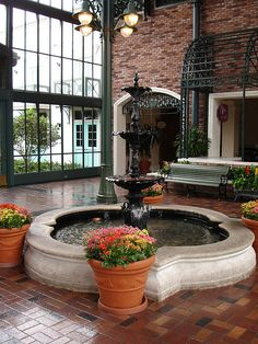 I love indoor fountains and court-yards!  (french quarter inspired court-yard)