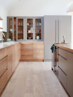 two-tone kitchen cabinets: Gray and Wood