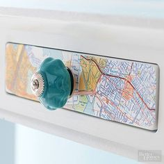 Add interest to an entry table or children's dresser with this simple solution for flea market maps. To create the inexpensive update, trace the shapes of drawers onto an old map. Cut out the pieces and apply matte decoupage to the back. After adhering, let it dry before applying a decoupage seal. For a funky finish, outfit the drawers with colorful pulls.