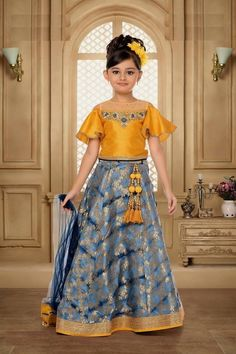 Children clothing is more casual and comfortable than adult clothing. Most off kid's girl wear a casual dress than ethnic dresses but on some special occasion some moms want that her baby girl look like a princess so for that here we presenting Blue And Grey Color Malai Satin And Digital Print Lehenga for festive season and special functions and event.
