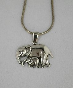 Sterling silver pendant of an elephant with its baby. Silver Jewellery, Silver Necklaces, Sterling Silver Pendants, Elephant Jewelry, Handcrafted Jewelry, Handmade, Bangles, Bright, Pendant Necklace